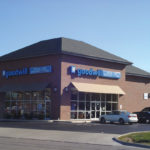 Goodwill storefront with sign on two sides of building that face the road