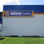 Napa AutoCare collision center sign on side of building