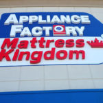 Sign on storefront of Appliance Factory and Mattress Kingdom in Columbus