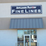 Sign on building for Appliance Factory Fine Lines furniture store in Columbus Ohio