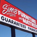 Tall professional sign outside of Sims Furniture and Mattress in Columbus Ohio