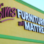 sign on building of Sims Furniture and Mattress in Columbus Ohio