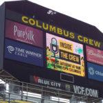 Columbus Crew soccer team scoreboard displaying various logos