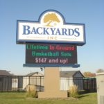 Large sign outside of Backyards Inc with digital display