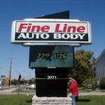 Fine Line Auto Body sign with time and temperature display