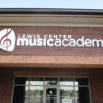 Lewis Center Music Academy sign on front of brick building in central Ohio