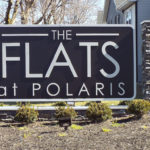 The Flats at Polaris sign outside of apartment buildings