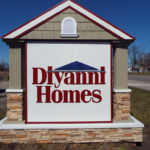 Diyanni Homes sign shaped like a house next to a road in Central Ohio