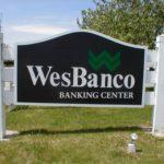 WesBanco sign on white picket fence frame