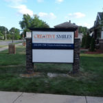 Creative Smiles sign with stone posts