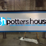 The Potters House sign in final stages of creation