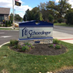 Schoedinger funeral and cremation service sign in front of building
