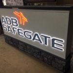 ADB Safegate neon sign in workshop