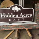 Sign in workshop for Hidden Acres East with stone base