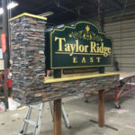 Sign in workshop for Taylor Ridge East with stone base