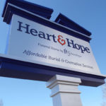Heart and Hope funeral home by Schoedinger sign by road