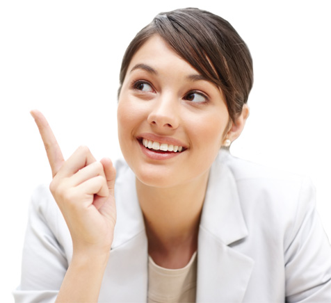 Woman in lab coat smiling and pointing upward
