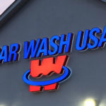 Car Wash USA neon sign on side of building
