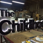 The Childhood neon sign in workshop
