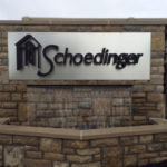 Metal sign above fountain outside of Schoedinger funeral home in central Ohio