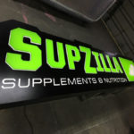 SupZilla neon sign in workshop