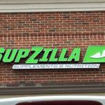 SupZilla Sign on brick storefront