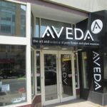 Aveda signs above and beside a salon entrance in Columbus OH