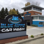 Blue Hippo Car Wash store with sign in foreground
