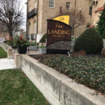 The Landing apartment complex with branded sign outside of brick building