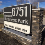Blacklick Business Park outdoor sign next to road