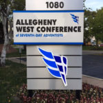 Allegheny West Conference of Seventh Day Adventists sign next to road