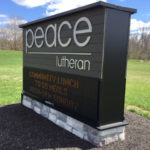 Peace lutheran church sign by road with digital display section
