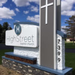 Modern sign next to road for High Street Baptist Church