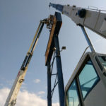 Crane to install signs