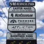 outdoor sign for SM business park featuring multiple businesses