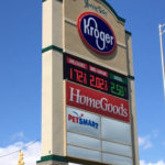 outdoor sign for Kroger Fuel Center and other stores in shopping center