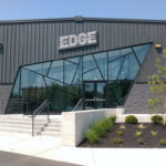 Edge sign on building with interesting asymmetrical windows