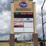 Tall sign by road for Kroger Marketplace shopping center